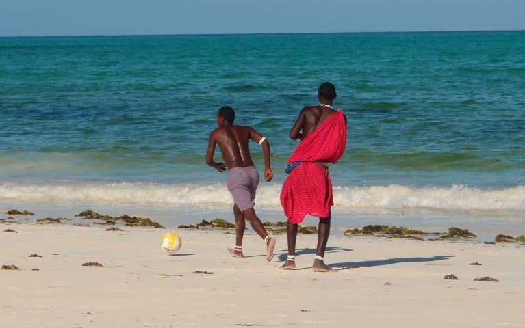 Masai people playing football on the beach