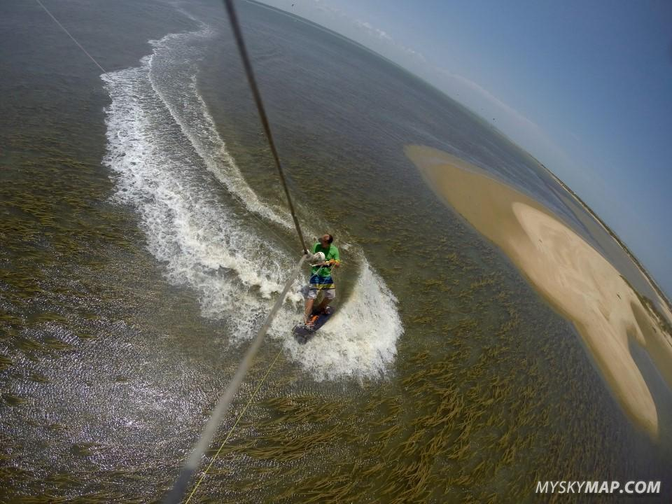 Kitesurfin above sea-grass
