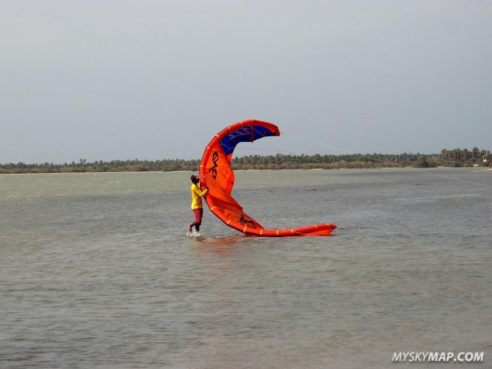 Beach boy launching a kite at Sri Lanka Kite